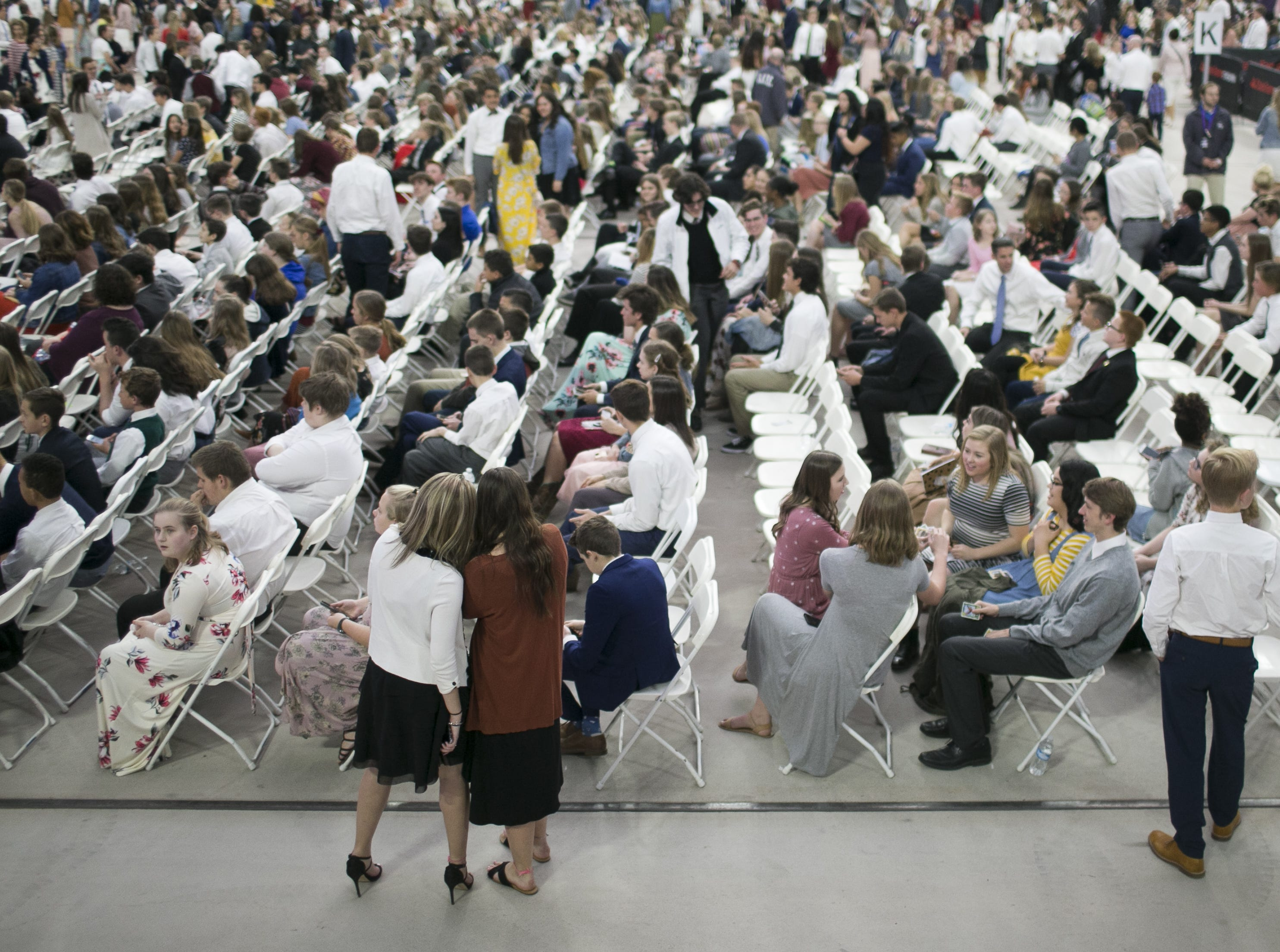 Members of the Church of Jesus Christ of Latter-day Saints wait to hear president Russell Nelson speak at State Farm Stadium in Glendale, Arizona on Sunday, Feb. 10, 2019.