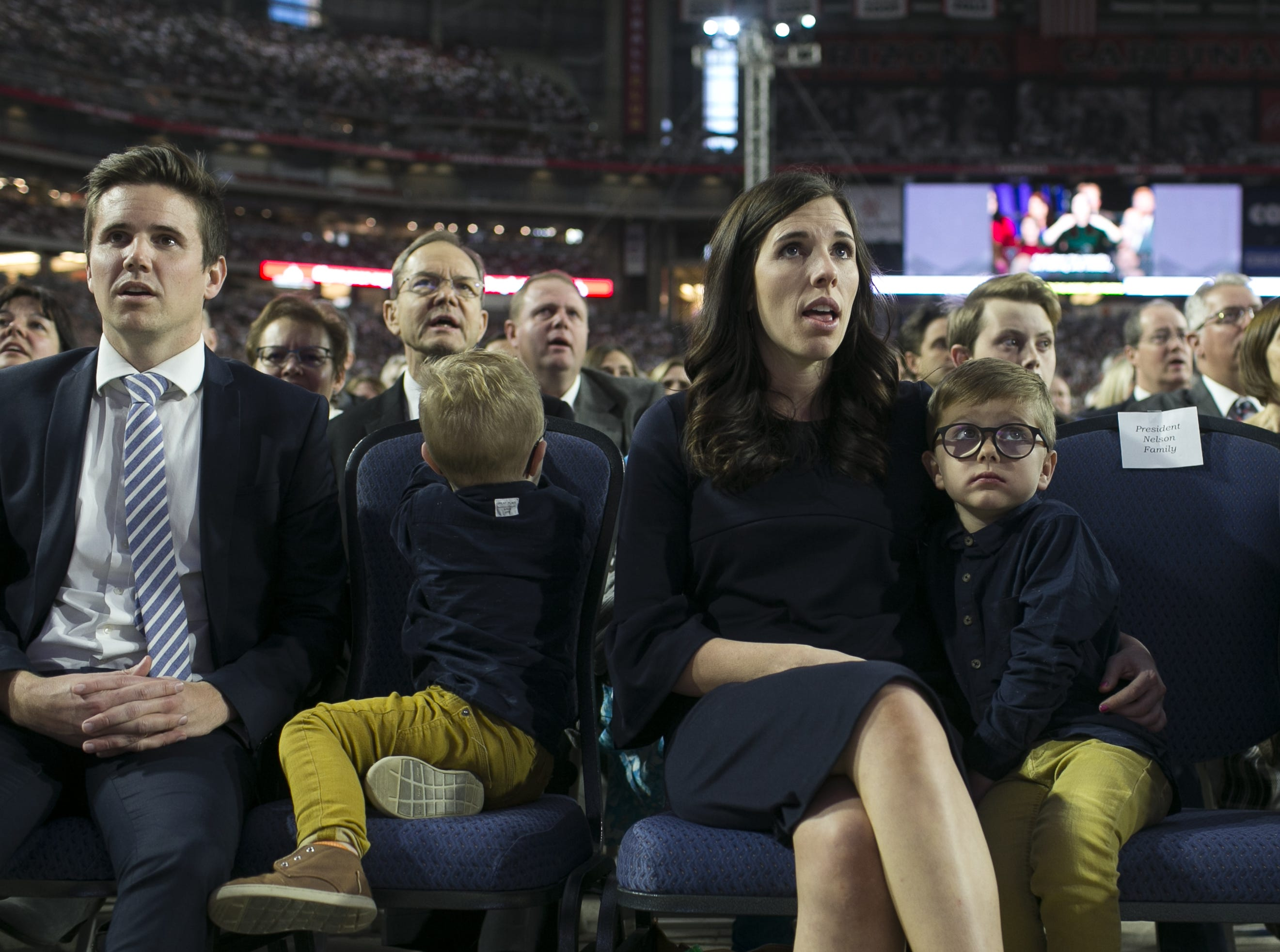Family of Russell Nelson, president of the Church of Jesus Christ of Latter-day Saints, sit in the front row as Nelson speaks to members of the church at a devotional at State Farm Stadium on Sunday, Feb. 10, 2019.