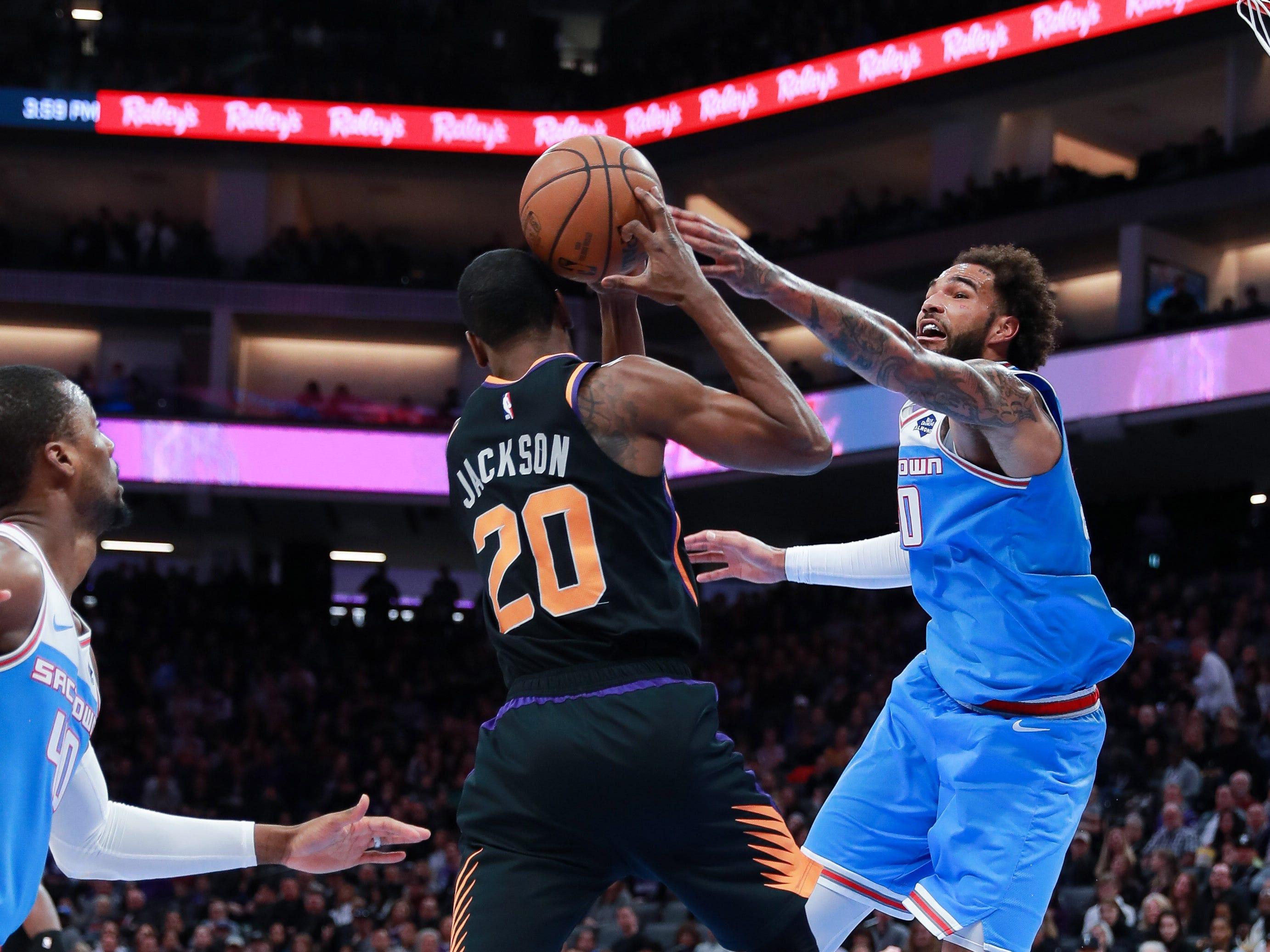 Feb 10, 2019; Sacramento, CA, USA; Sacramento Kings center Willie Cauley-Stein (00) battles for a rebound with Phoenix Suns forward Josh Jackson (20) during the second quarter at Golden 1 Center.