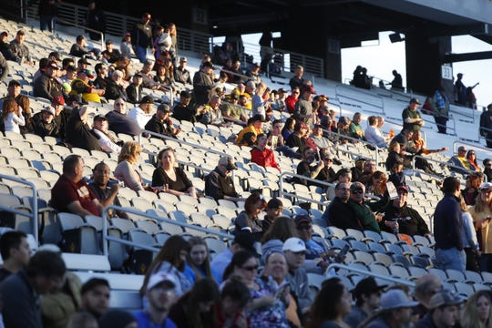 Fans come to their seats before the start of the Arizona Hotshots' opener against the Salt Lake Stallions.