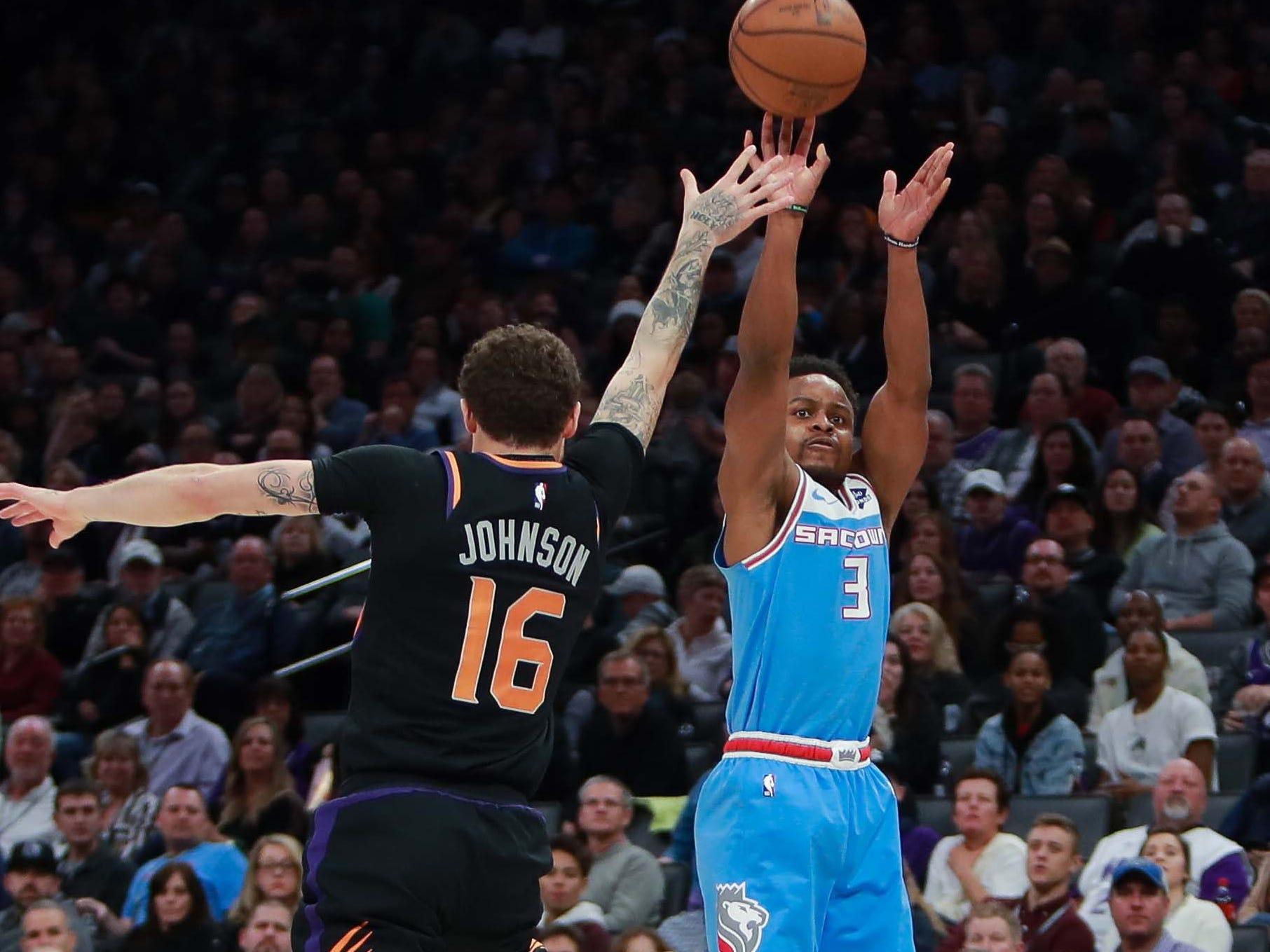 Feb 10, 2019; Sacramento, CA, USA; Sacramento Kings guard Yogi Ferrell (3) shoots the ball against Phoenix Suns guard Tyler Johnson (16) during the fourth quarter at Golden 1 Center.