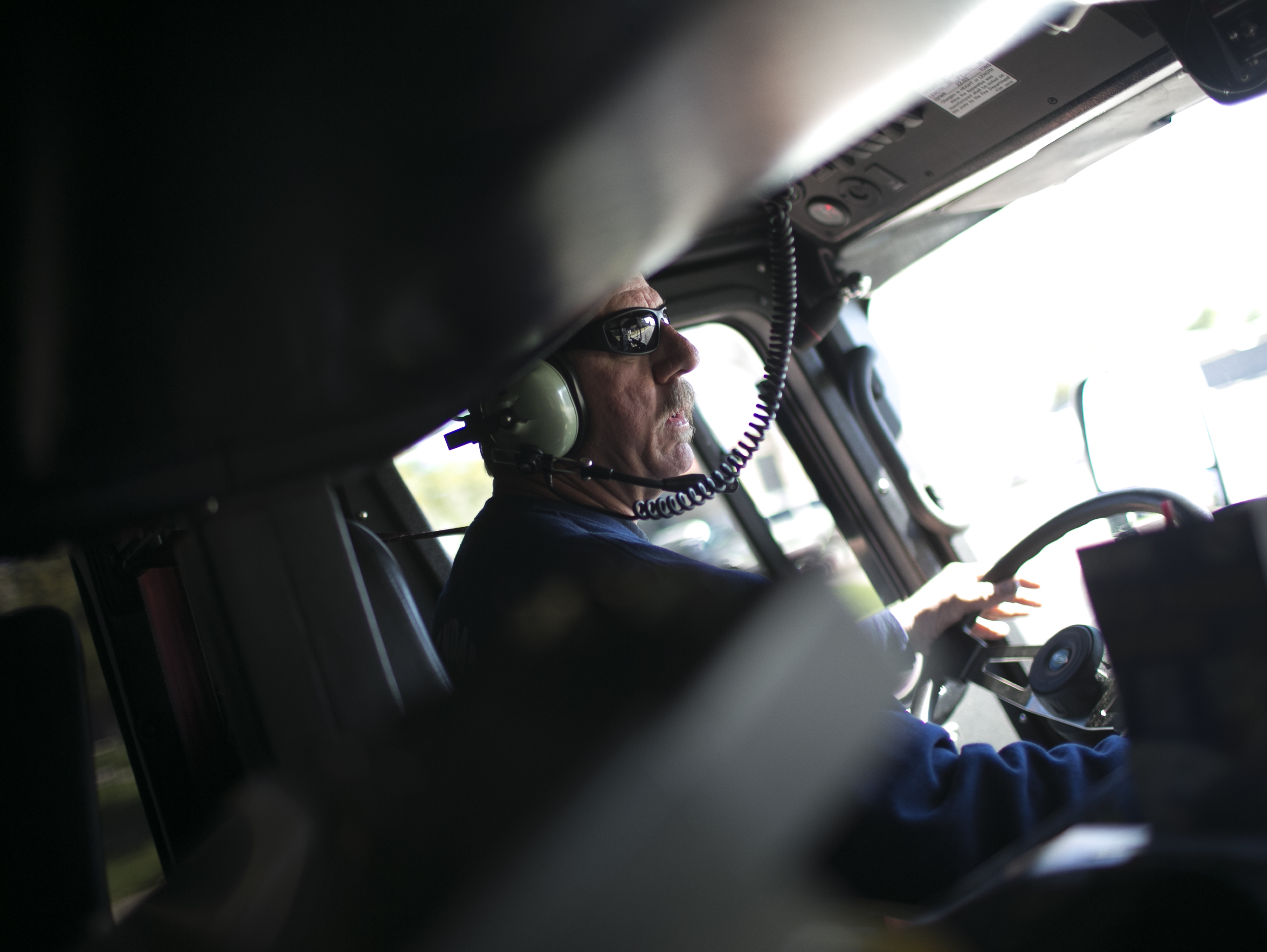 Firefighter Jim Strong drives a fire truck on a call with Glendale Fire Department 154 on Feb. 7, 2019, in Glendale.