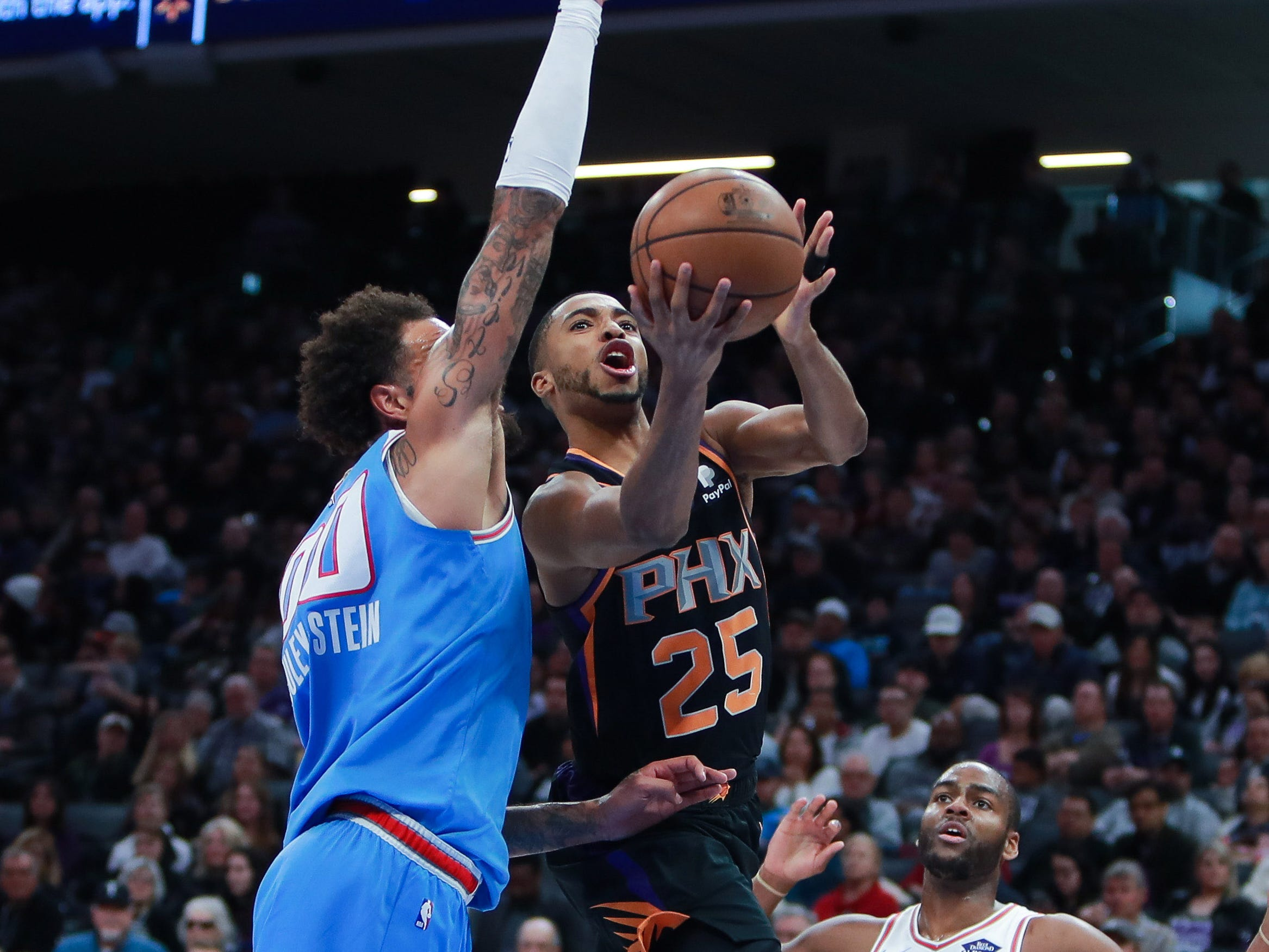 Feb 10, 2019; Sacramento, CA, USA; Phoenix Suns forward Mikal Bridges (25) shoots the ball over Sacramento Kings center Willie Cauley-Stein (00) during the second quarter at Golden 1 Center.