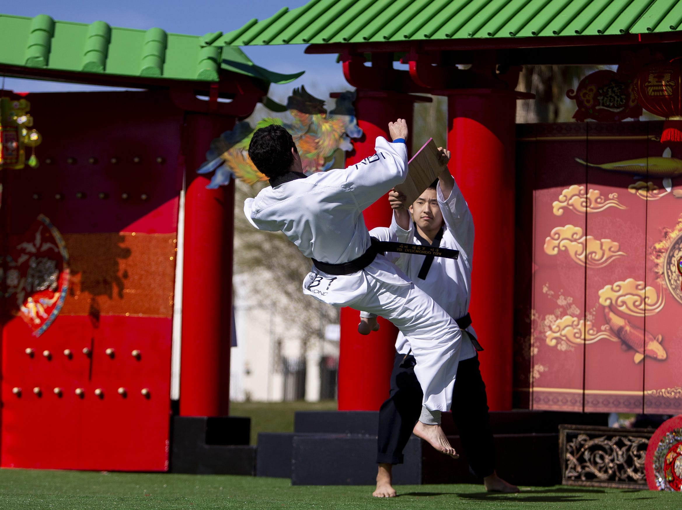 Elicio Peña, left, and Timothy Yi take part in the NB Taekwondo demo performance at the Chinese Week Culture and Cuisine Festival on Feb. 10, 2019, in Margaret T. Hance Park.