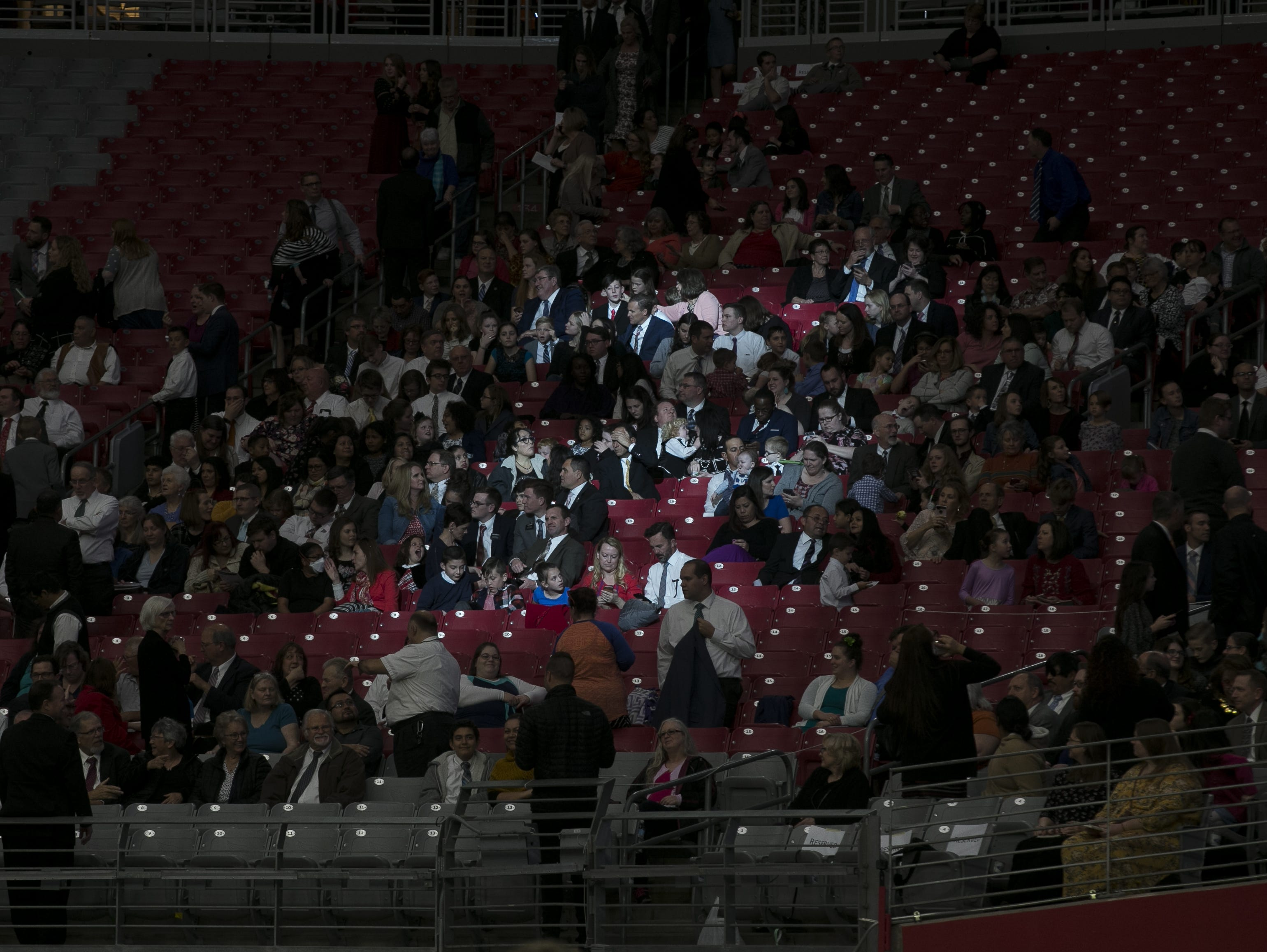 Members of the the Church of Jesus Christ of Latter-day Saints wait to hear President Russell Nelson speak at a devotional at State Farm Stadium on Sunday, Feb. 10, 2019.