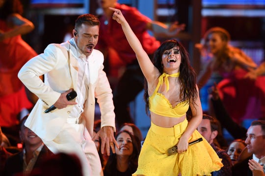 Puerto Rican singer Ricky Martin and US-Cuban singer-songwriter Camila Cabello perform during the 61st Annual Grammy Awards on February 10, 2019, in Los Angeles.