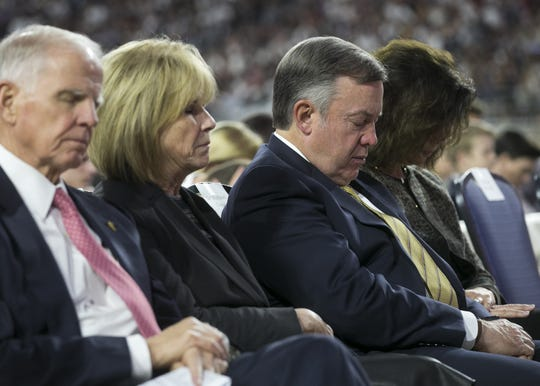 Arizona State University president Michael Crow prays with members of the Church of Jesus Christ of Latter-day Saints at State Farm Stadium before a devotional in Glendale on Sunday, Feb. 10, 2019.