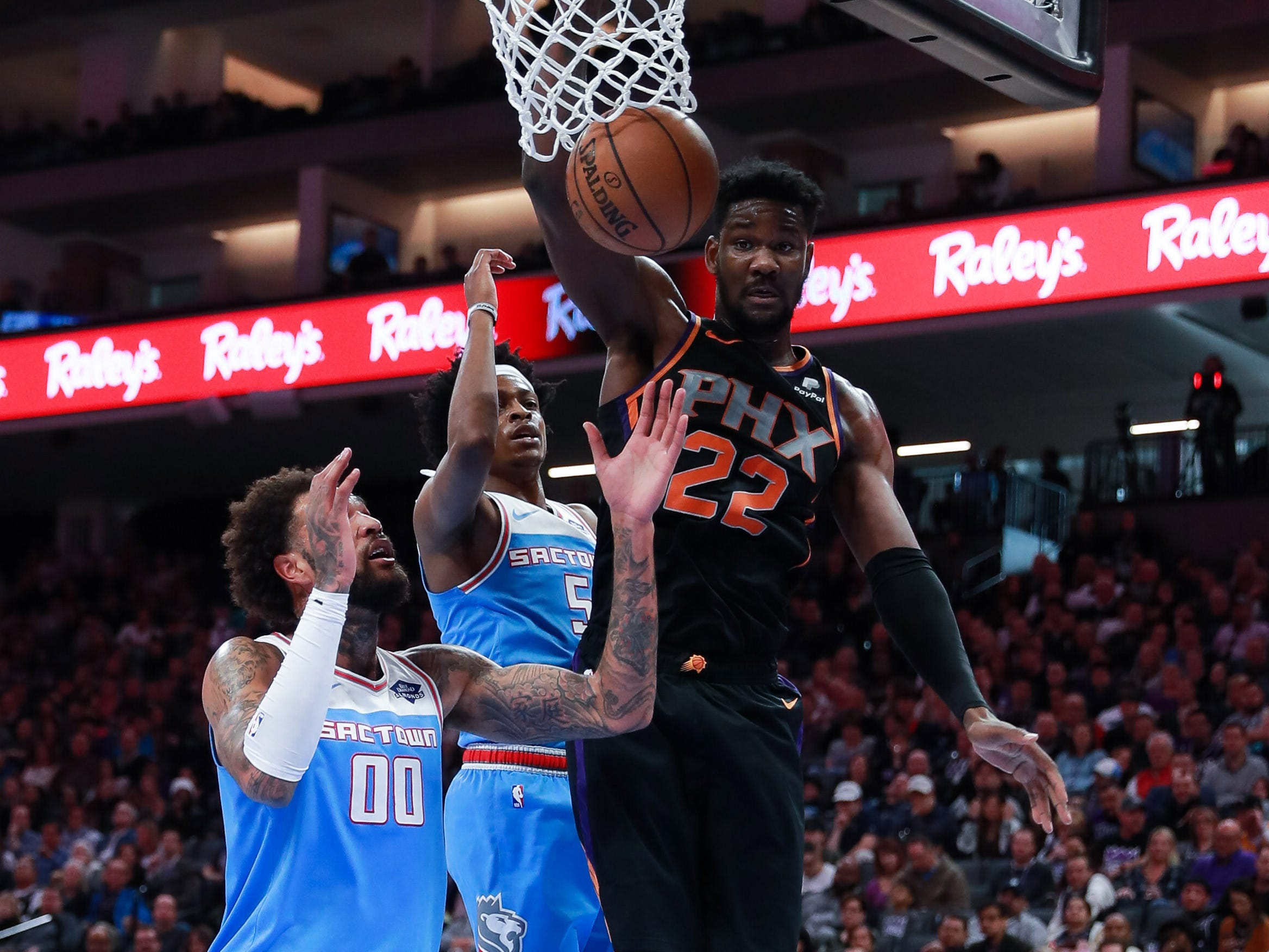 Feb 10, 2019; Sacramento, CA, USA; Phoenix Suns center Deandre Ayton (22) dunks the ball over Sacramento Kings center Willie Cauley-Stein (00) during the second quarter at Golden 1 Center.