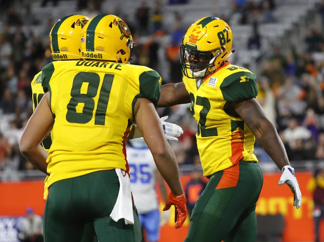 Thomas Duarte (81) celebrates with Gerald Christian (82) after Christian's touchdown reception against the Stallions during the first half of a game Feb. 10 at Sun Devil Stadium.