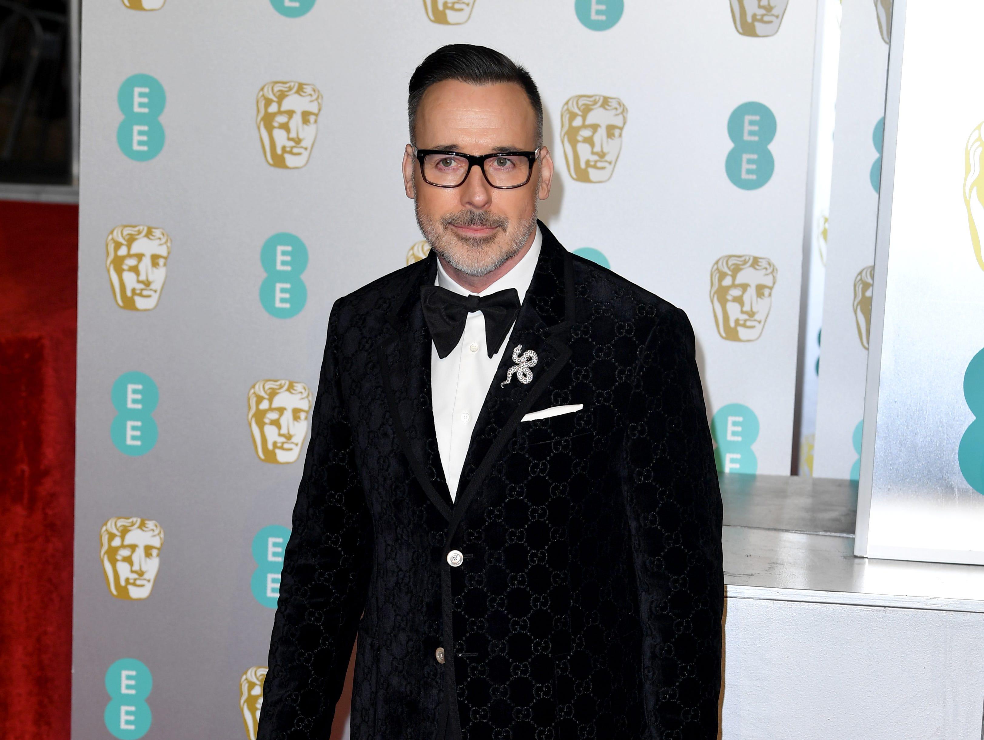 David Furnish a su llegada a la alfombra roja de los Premios de la Academia Británica de Cine BAFTA en el Royal Albert Hall en Londres el 10 de febrero de 2019.