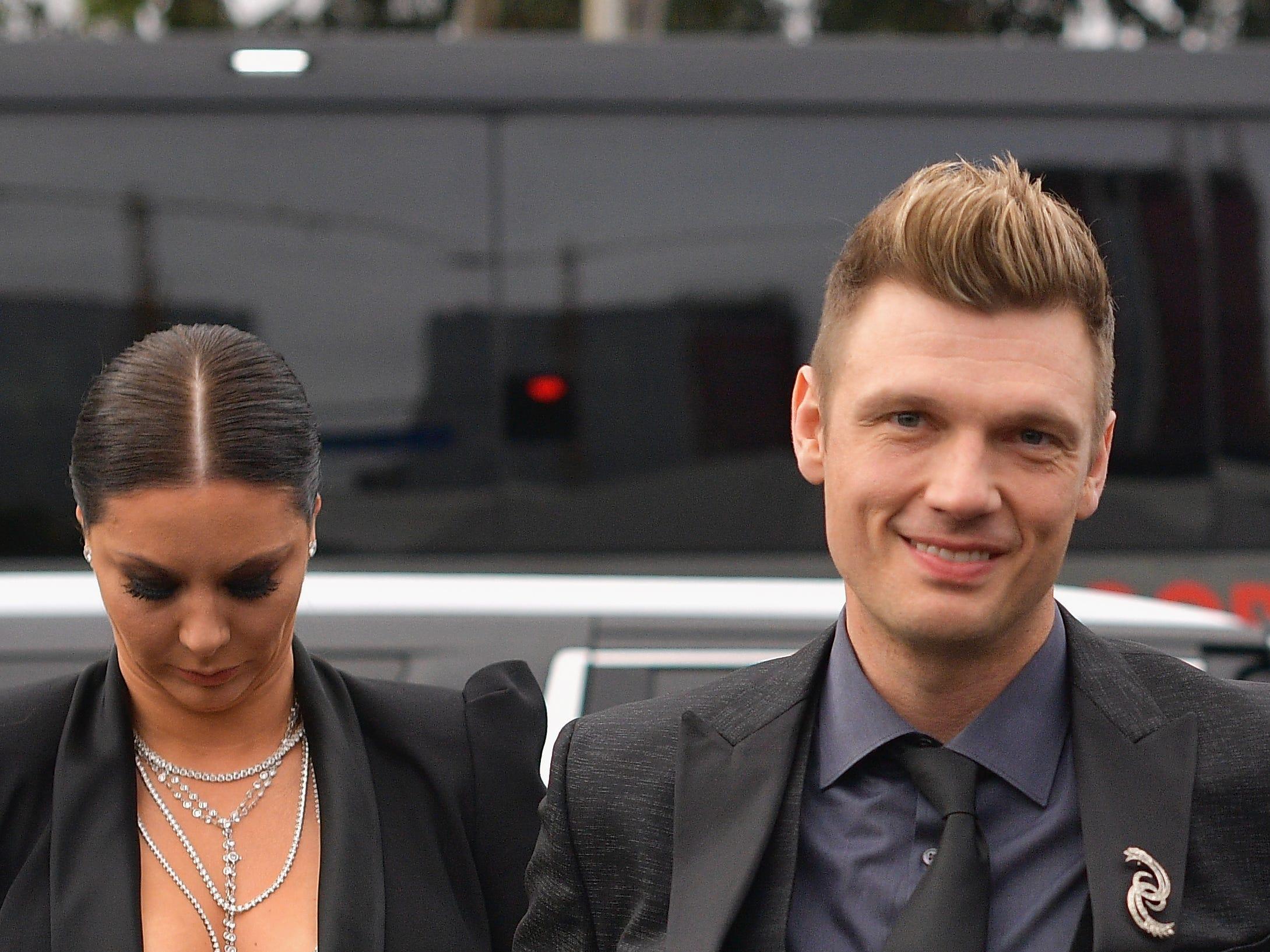 Lauren Kitt (iz) y Nick Carter asisten a la 61ª edición de los premios GRAMMY en el Staples Center el 10 de febrero de 2019 en Los Ángeles, California.