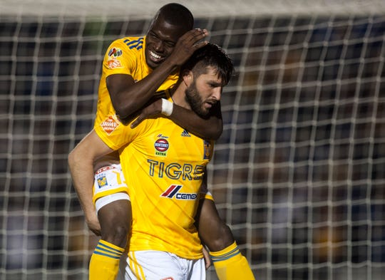 Tigres' French player Andre Pierre Gignac (bottom) celebrates with Ecuadoran teammate Enner Valencia, after scoring against Santos, during the Mexican Clausura 2019 tournament football match at the Universitario stadium in Monterrey, Mexico, on February 2, 2019. (Photo by Julio Cesar AGUILAR / AFP)        (Photo credit should read JULIO CESAR AGUILAR/AFP/Getty Images)