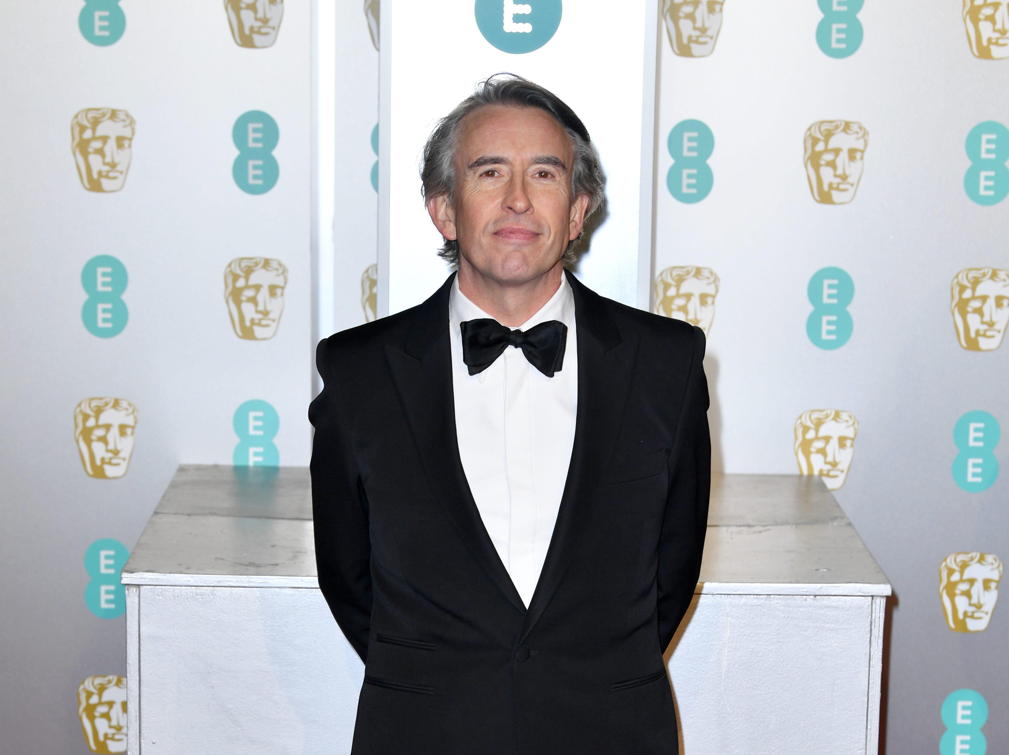 Steve Coogan a su llegada a la alfombra roja de los Premios de la Academia Británica de Cine BAFTA en el Royal Albert Hall en Londres el 10 de febrero de 2019.