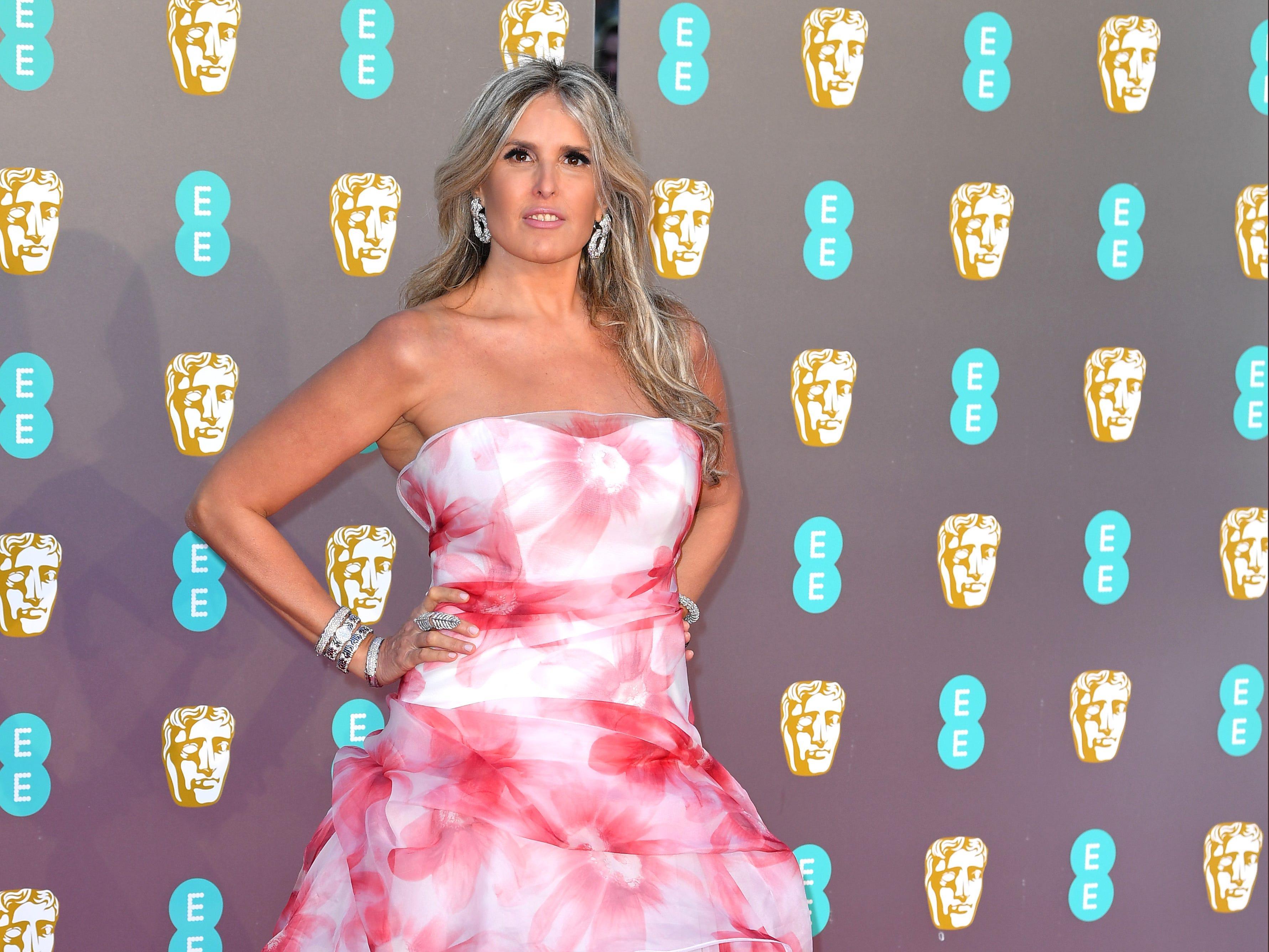 Tiziana Rocca a su llegada a la alfombra roja de los Premios de la Academia Británica de Cine BAFTA en el Royal Albert Hall en Londres el 10 de febrero de 2019.