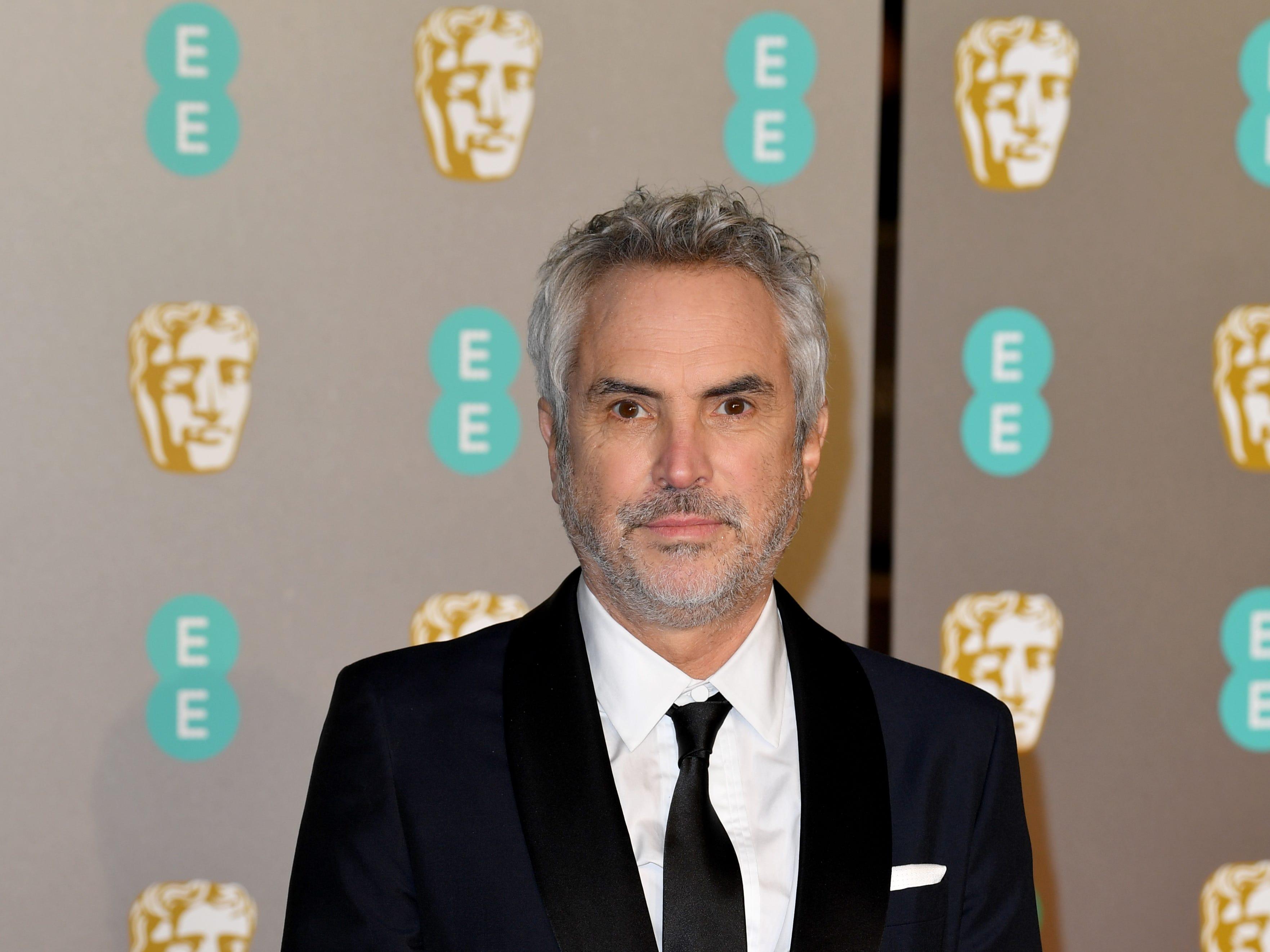 El director Alfonso Cuarón a su llegada a la alfombra roja de los Premios de la Academia Británica de Cine BAFTA en el Royal Albert Hall en Londres el 10 de febrero de 2019.