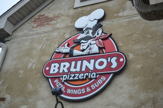 The gregarious chef on the Bruno's Pizzeria sign in Marblehead was created by Davenport using the bas relief sculpture technique.
