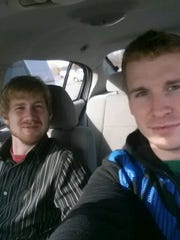 Kevin Anderson Jr., left, pictured with his brother Adam. Investigators said Kevin Edward Anderson Jr. was shot on the side of Keewahdin Road near Campbell Road before being pushed into a ditch to die early Sunday.