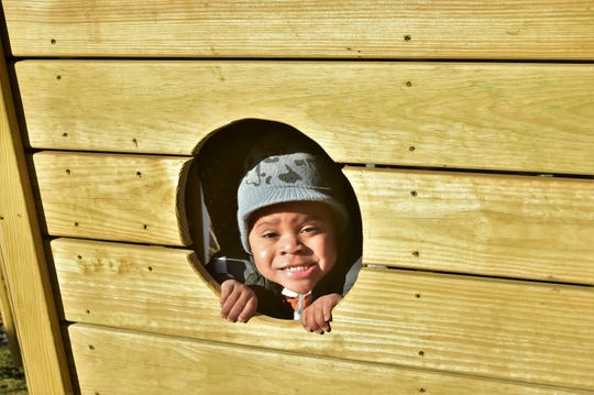 Dontae Jackson looks out through a port hole in his pirate ship play set on Saturday, Feb. 9, 2019. Jackson, who suffers from  acute flaccid myelitis, enterovirus (a respiratory illness) and brain stem encephalitis, recently received the play set through the Make-A-Wish Foundation.