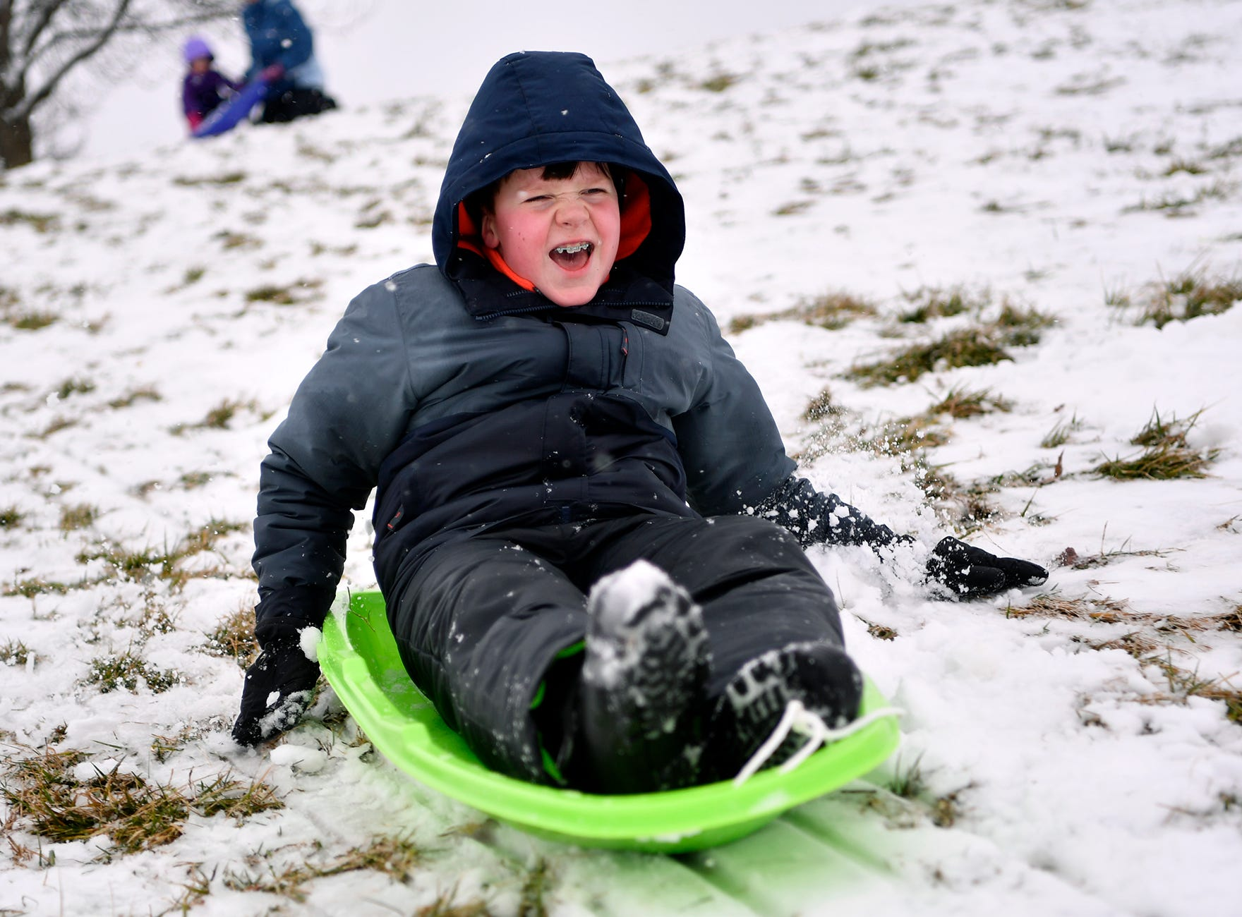 Zachary Shiffer, 11, zips down the hill while sledding with his family at Springettsbury Park, Monday, February 11, 2019.John A. Pavoncello photo