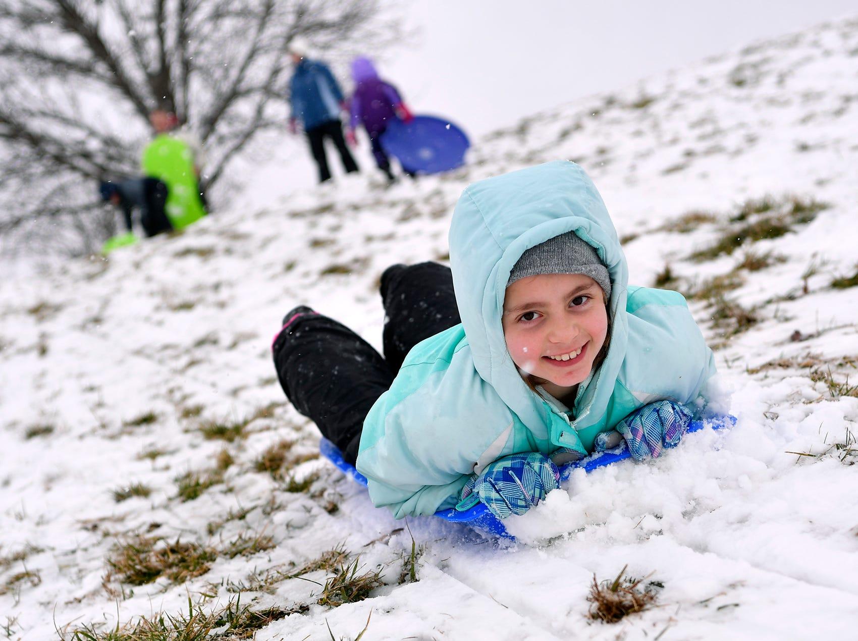 Katelyn Shiffer, 9, enjoys a snow day at Springettsbury Park with her family, Monday, Feb. 11, 2019. John A. Pavoncello photo