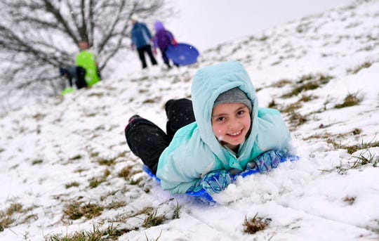 Katelyn Shiffer, 9, enjoys a snow day at Springettsbury Park with her family, Monday, Feb. 11, 2019. John A. Pavoncello photo