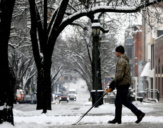 J. Daniel Enterprises employee Nicholas Wilson clears the sidewalk on West Market Street in York City Monday, Feb. 11, 2019. Forecasters say a mix of sleet, snow and rain is on tap for the area into Tuesday. Bill Kalina photo