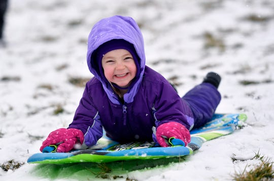 Allison Shiffer, 5, sleds with her family at Springettsbury Park, Monday, Feb. 11, 2019. John A. Pavoncello photo