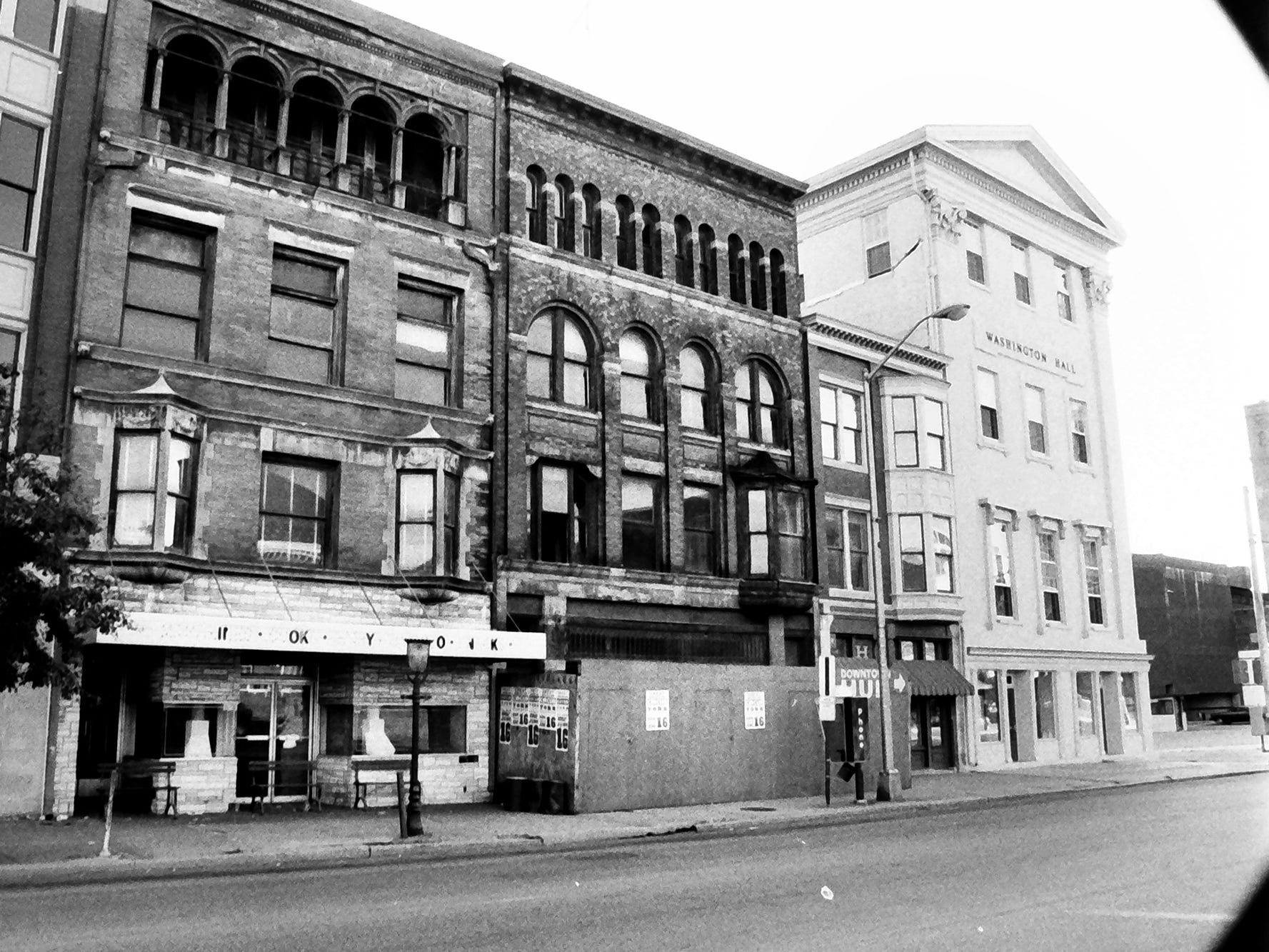 In 1985, a row of dilapidated buildings on the west side of the 200 block of South George street were about to be revitalized. The facade's were retained and a modern building with a parking garage was constructed inside and beneath. It was the home of the York Daily Record in the 1990s and today the home of Family First Health. Washington Hall, at right, stands as it did in 1985.