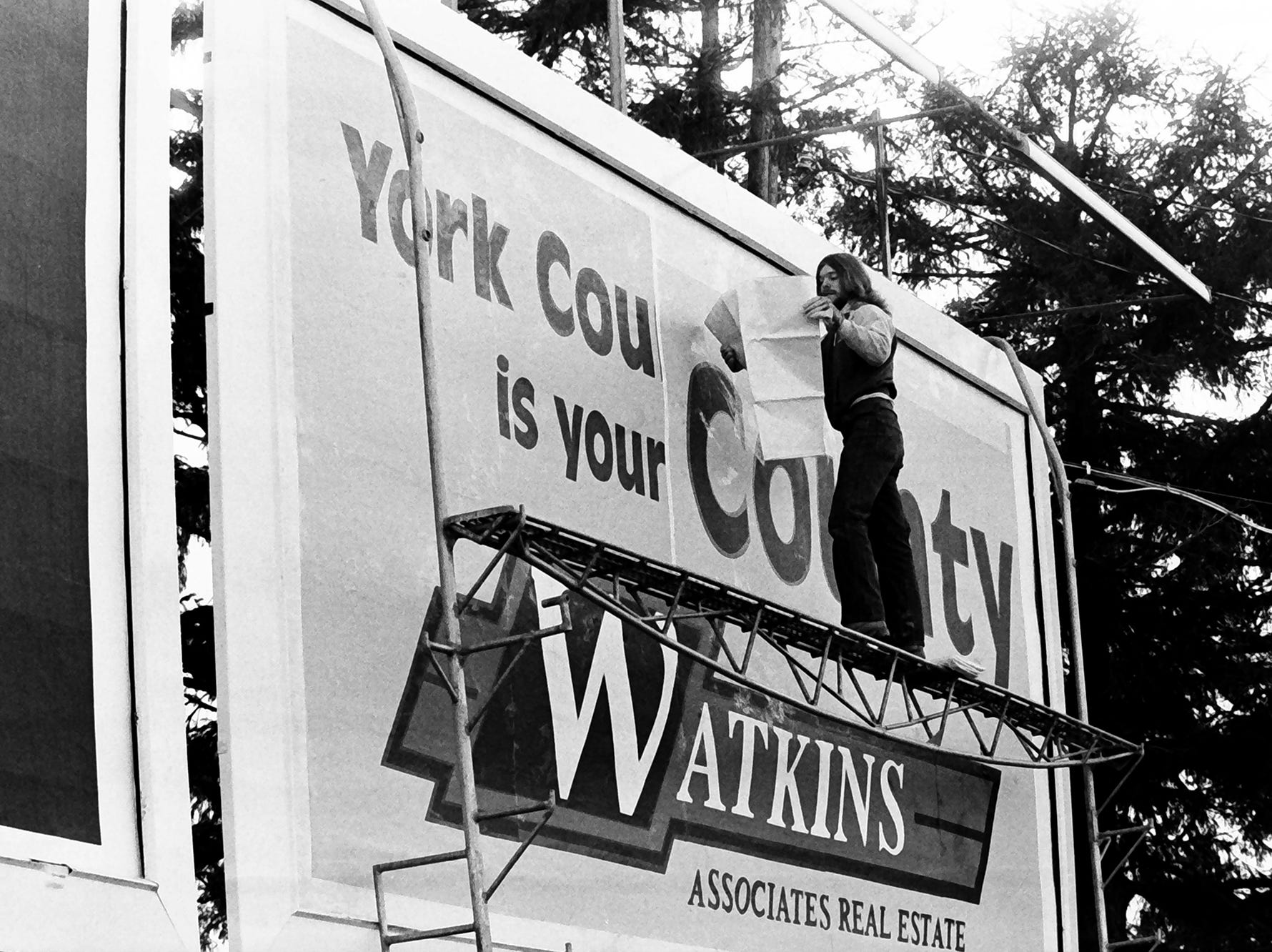 In 1985, York County was growing in population.  Ed Dempsey of Penn Advertising installs a new billboard.