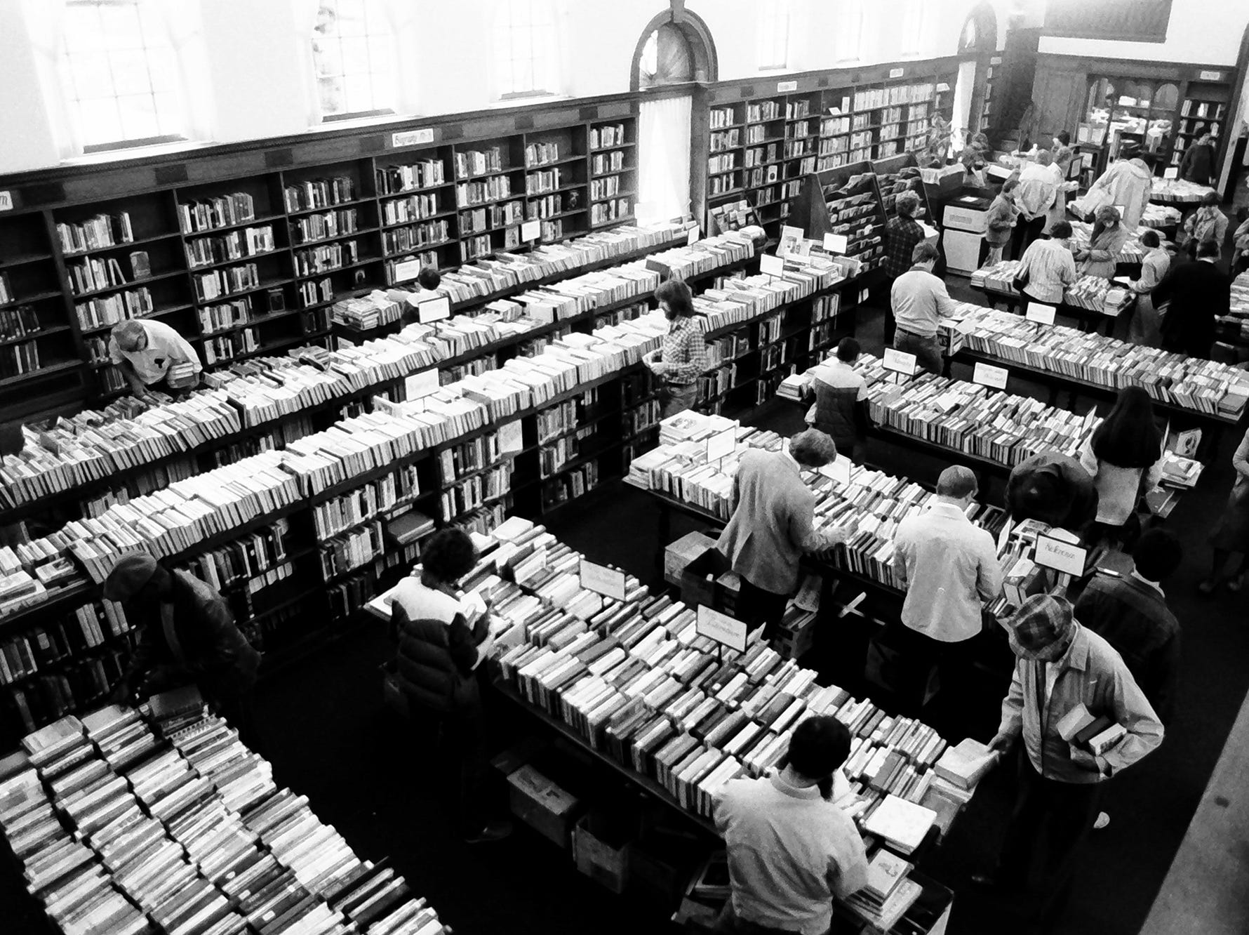 In 1985, the main reading room of Martin Library was full of books in what looks like a book sale.
