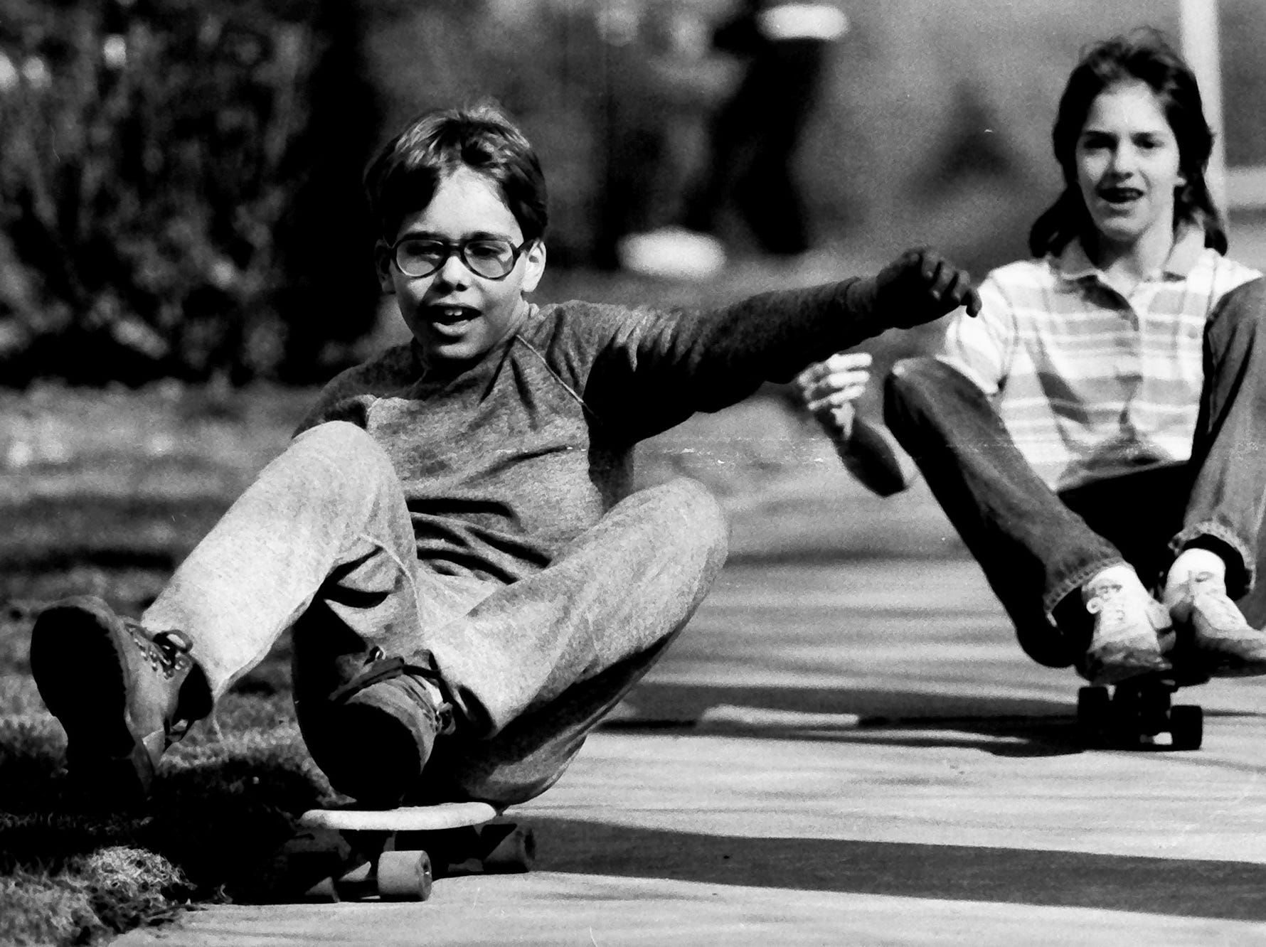 In 1985, boys sat on skateboards and rode down sidewalks.