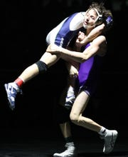 Spanish Springs Devin Griffen scores a major-decision victory (9-1) over Damonte Ranch's Bryce Bell in the 113-pound 4A state championship on Saturday at the Winnemucca Events Center.