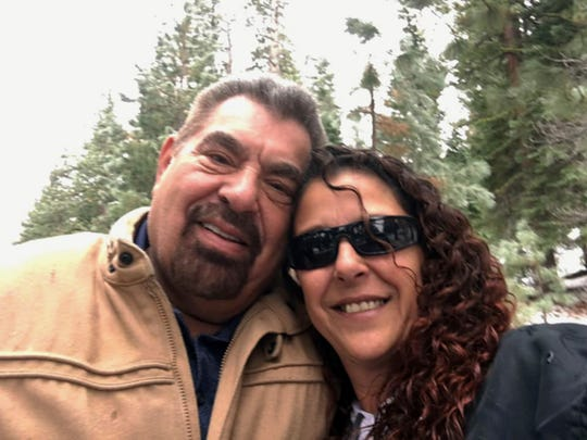 This Dec. 24, 2018, selfie by Julia Ackley shows herself and her father, Antonio Pastini, at Lake Tahoe near Carson City, Nev. Pastini, who had also gone by Jordan Isaacson and was known for years as Ike, was killed while piloting a small plane that crashed into a house in Yorba Linda, Calif., Sunday, Feb. 3, 2019. (Julia Ackley via AP, File)