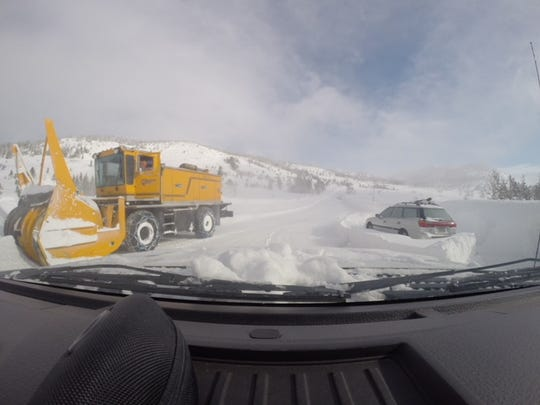 A photo taken from a Nevada Department of Transportation vehicle on Mt. Rose Highway as a snowblower passes a stranded vehicle on Sunday, Feb. 10.