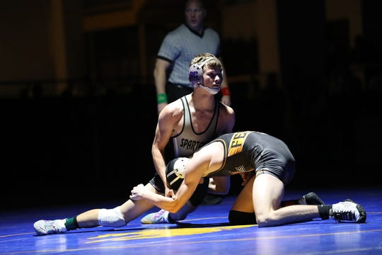 Spring Creek's Q Boyd defeats Fernley's Kyle Jones, 9-6, in the 138-pound 3A state championship on Saturday at the Winnemucca Events Center.