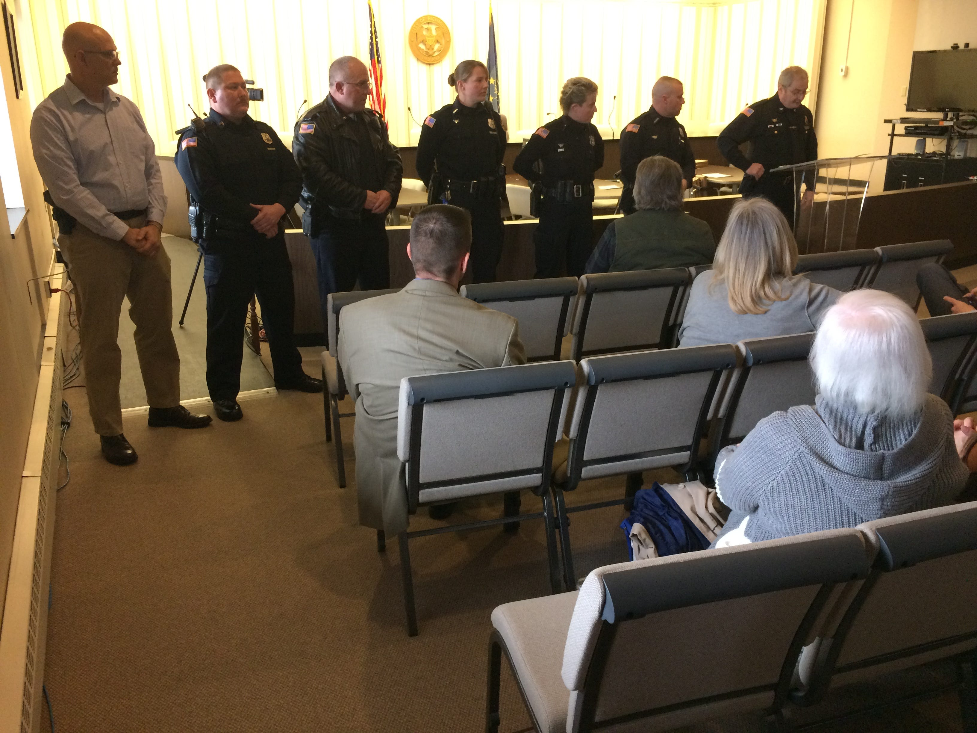 Richmond Police Department's Detective Neal VanMiddlesworth, Sgt. Andrew Jury, Officer Randy Ruhl, Officer Renee Ware, Officer Ami Miller and Officer Mike Black were awarded Police Stars on Monday. They listen to Chief Jim Branum talk about the awards.