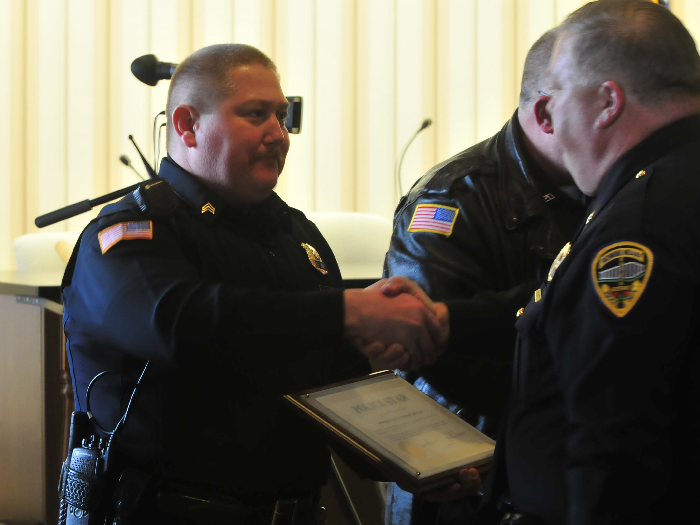 Sgt. Andrew Jury receives a Police Star award from Major Mike Britt on Monday.