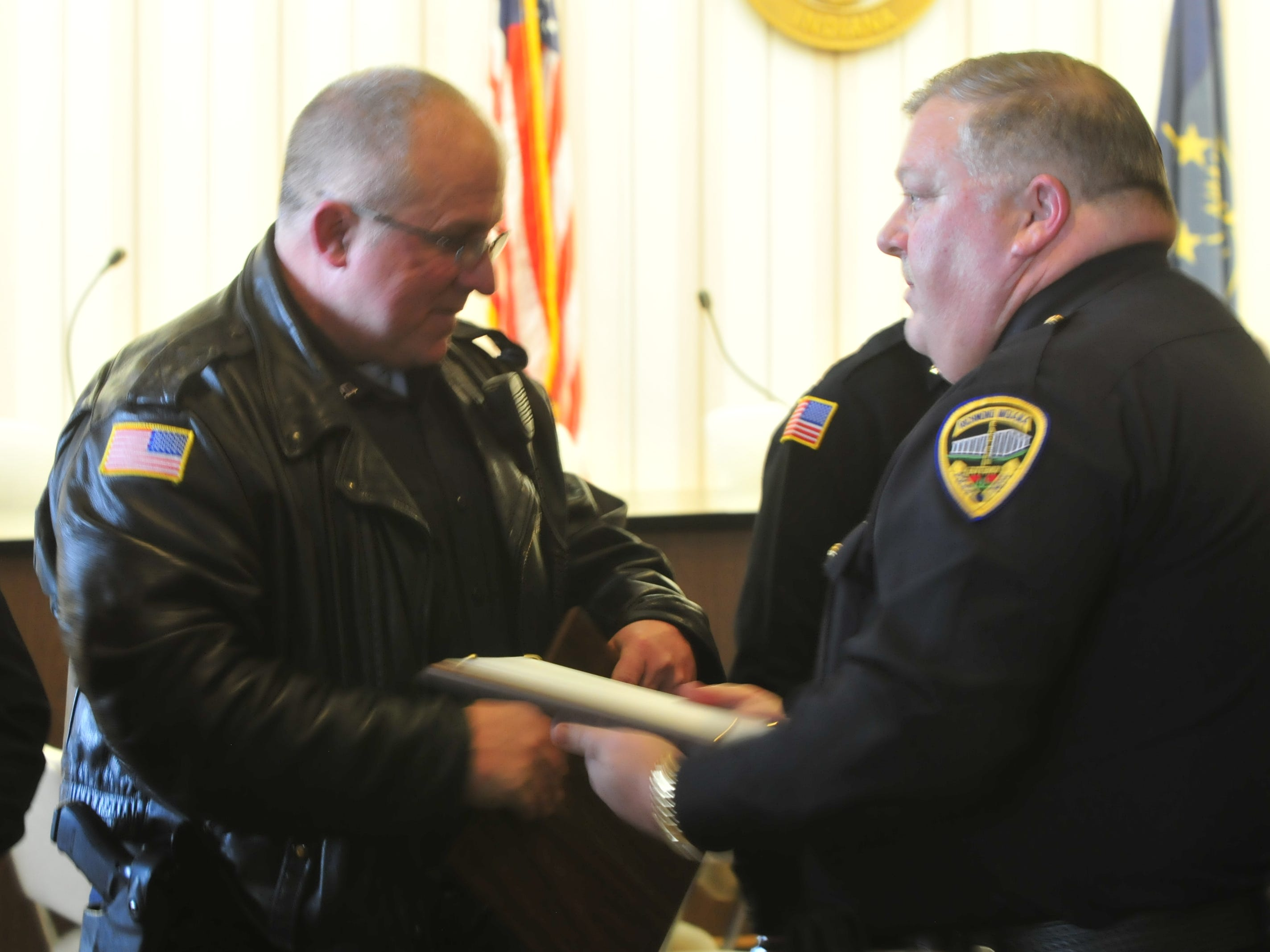 Officer Randy Ruhl receives a Police Star award from Major Mike Britt on Monday.