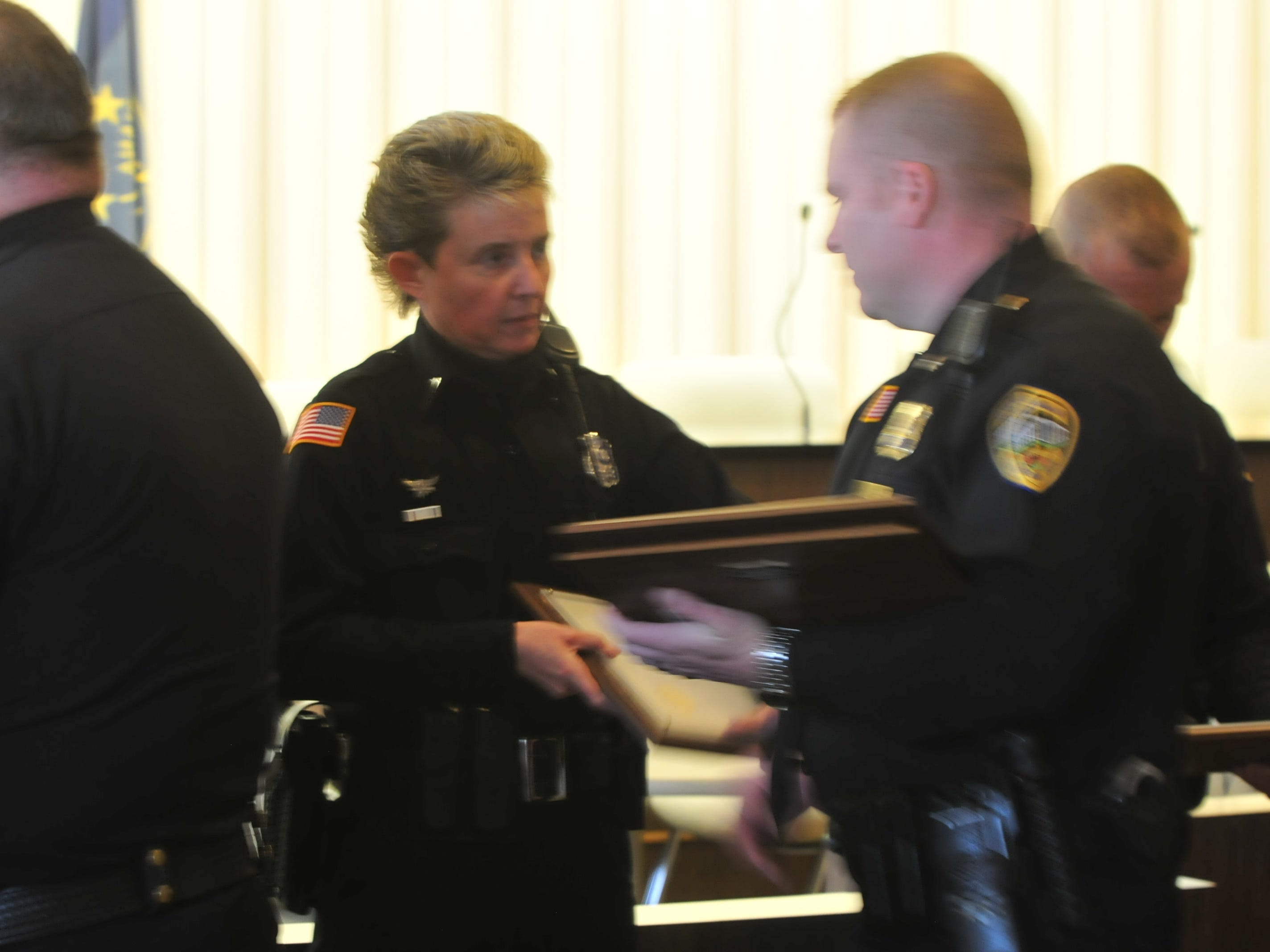Officer Ami Miller is presented a Police Star award by Major Jon Bales on Monday.