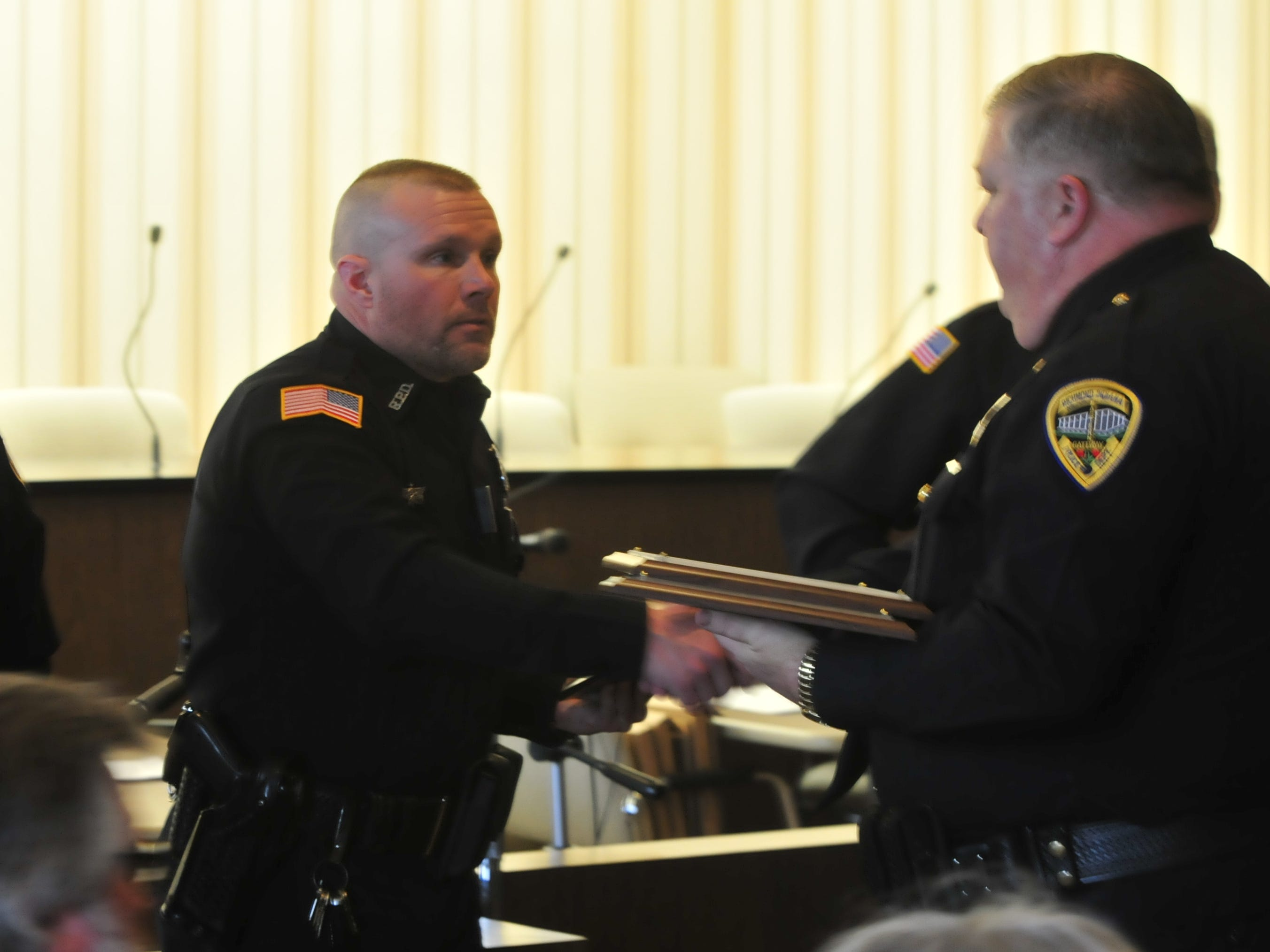 Officer Mike Black is presented a Police Star award by Major Mike Britt on Monday.