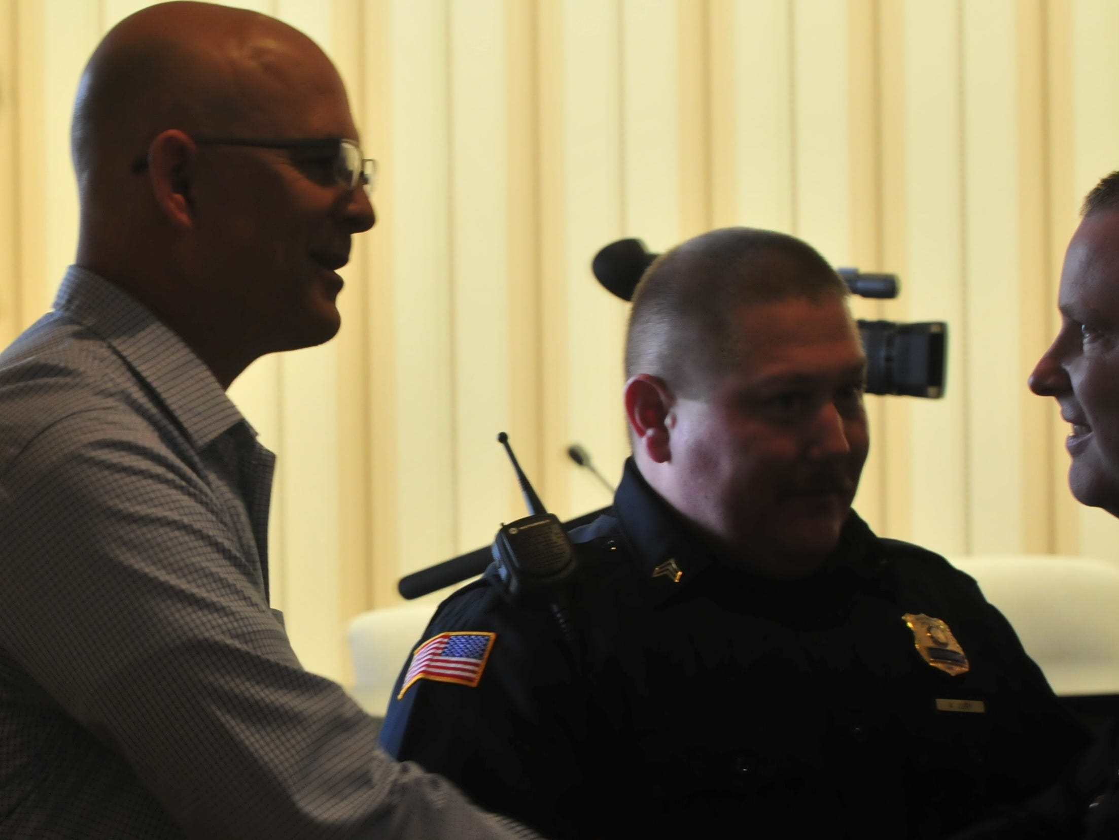 Detective Neal VanMiddlesworth is presented with a Police Star award by Major Jon Bales on Monday.