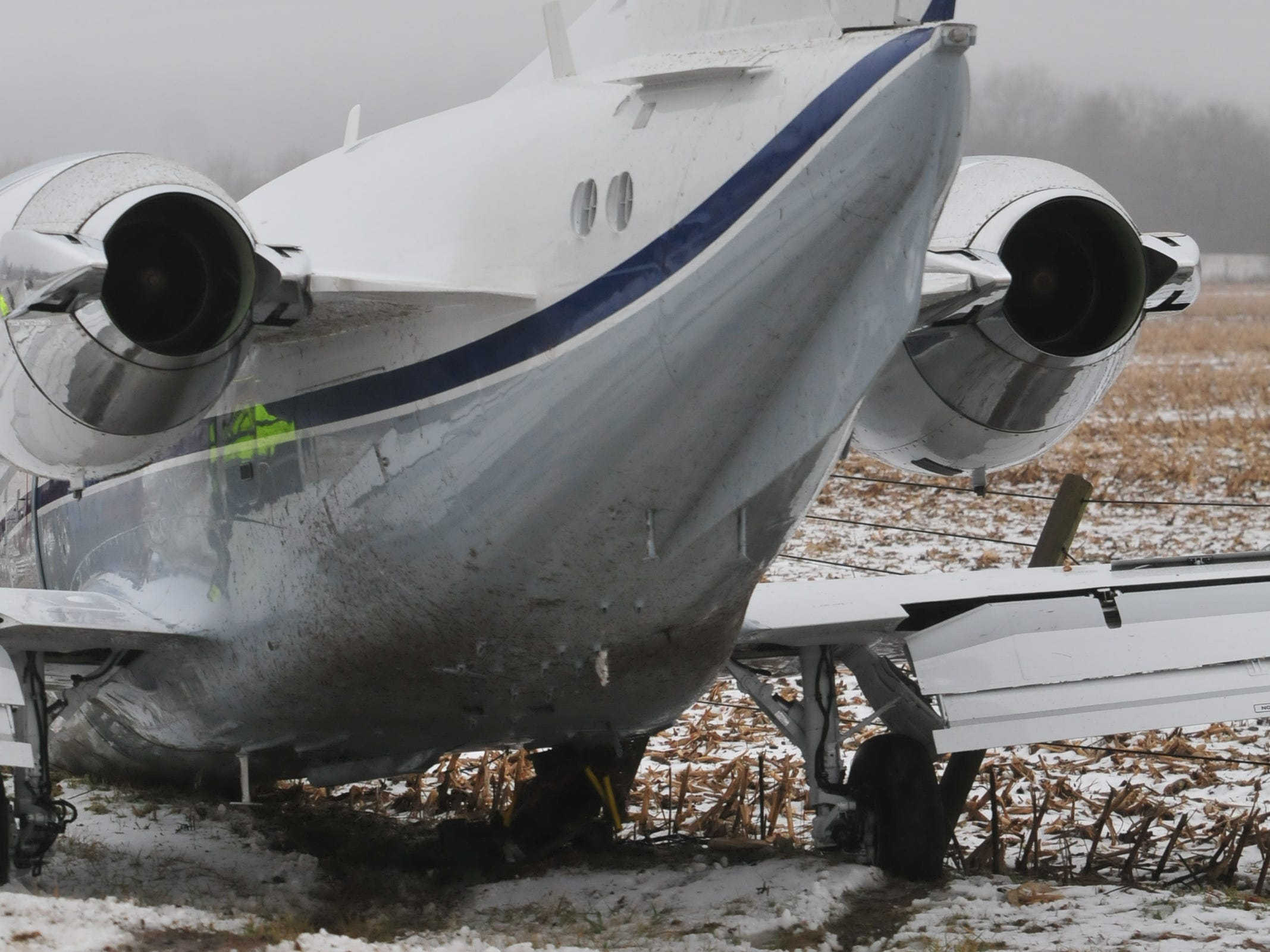 A chartered airplane skidded on a snow-covered, Richmond Municipal Airport runway Monday. It plowed off the runway, through a field, across Indiana 227 and into a fence.