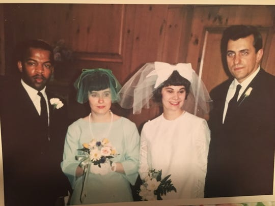 Congressman John Lewis (l) as best man at wedding of Rev. Kenneth and Mary Dean. (Second from left is Mary Dean's friend, Adrienne Howard.)