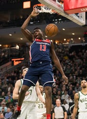 Washington Wizards center Thomas Bryant (13) dunks during the third quarter against the Milwaukee Bucks at Fiserv Forum on Feb. 9, 2019.