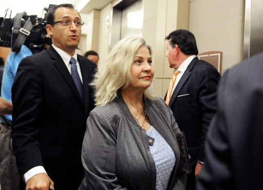 FILE - In this April 29, 2016, file photo, Sandra Merritt is surrounded by her attorneys as she leaves a courtroom after a hearing in Houston. Planned Parenthood has made an unusual legal demand to join California's criminal prosecution of two anti-abortion activists charged with invasion of privacy for secretly making videos as they tried to buy fetal material from the organization. (AP Photo/Pat Sullivan, File)
