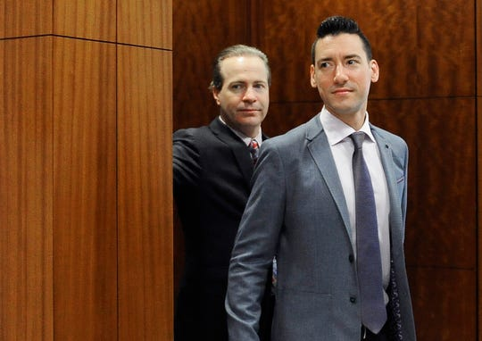 FILE - In this April 29, 2016, file photo, David Daleiden, right, leaves a courtroom with attorney Jared Woodfill after a hearing in Houston. Planned Parenthood has made an unusual legal demand to join California's criminal prosecution of two anti-abortion activists charged with invasion of privacy for secretly making videos as they tried to buy fetal material from the organization. (AP Photo/Pat Sullivan, File)