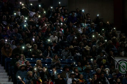 The audience hold up their cell phones to a song during the San Angelo Stock Show & Rodeo matinee show Sunday, Feb. 10, 2019, at Foster Communications Coliseum.