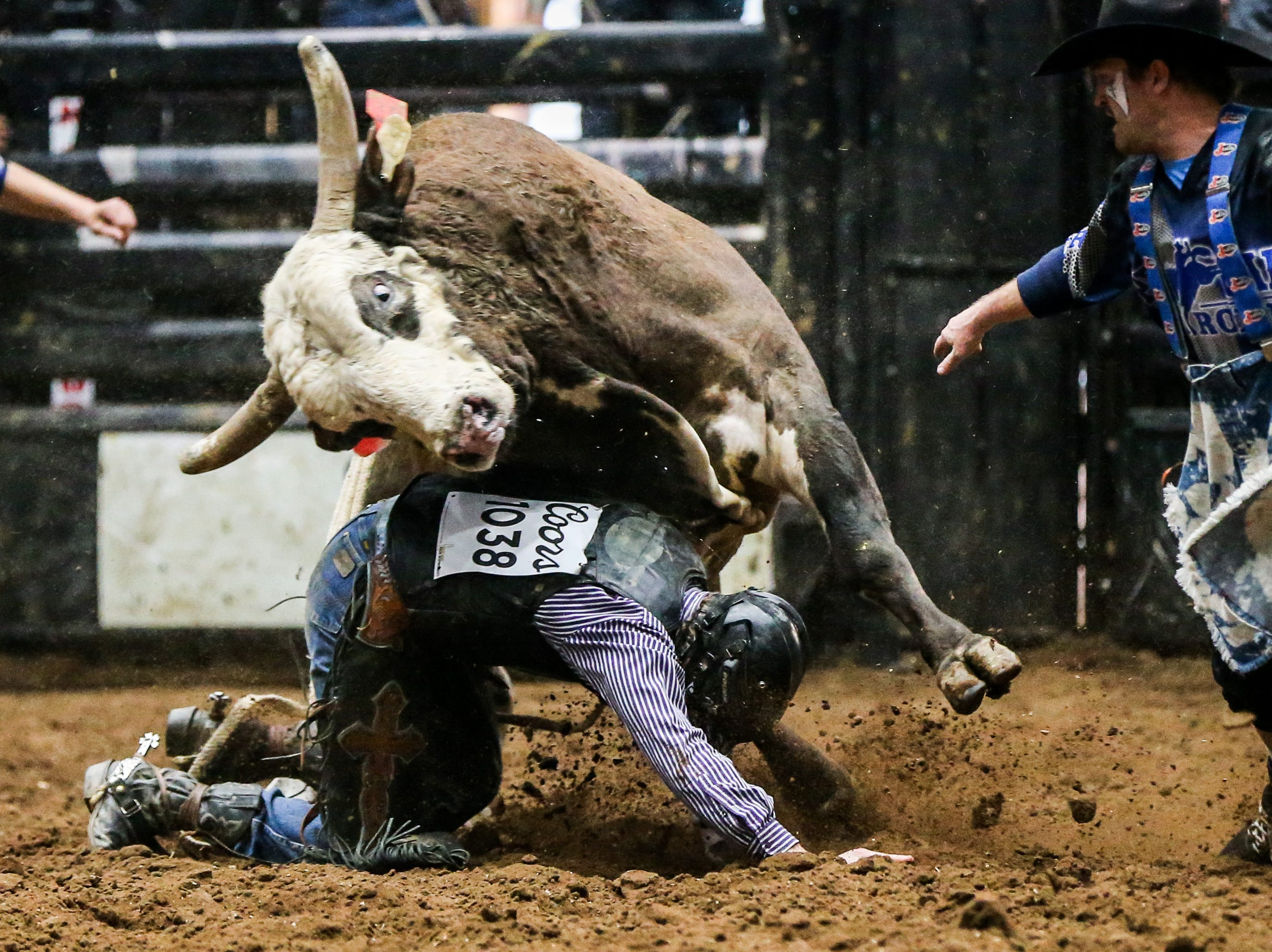 Colten Beaty is tackled by bull after his fall during the San Angelo Stock Show & Rodeo matinee show Sunday, Feb. 10, 2019, at Foster Communications Coliseum.
