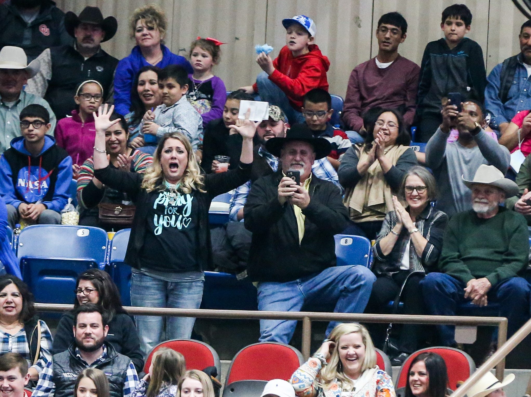 Families cheer on their mutton bustin' kids during the San Angelo Stock Show & Rodeo matinee show Sunday, Feb. 10, 2019, at Foster Communications Coliseum.