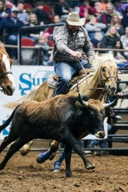 Gary Gilbert rides out to steer wrestle during the San Angelo Stock Show & Rodeo matinee show Sunday, Feb. 10, 2019, at Foster Communications Coliseum.